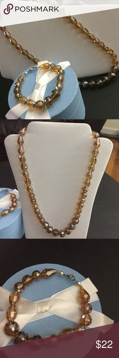 """Champagne Necklace & Bracelet Set Multi shape, multi colored glass beads in the champagne color range. New with tags, necklace measures 20"""", bracelet measures almost 8"""" but due to the bulk of the beads fits more like a 7-7.5"""".  I also expect this set in sweet pink in the next few days ❤. N77 Jewelry Necklaces"""