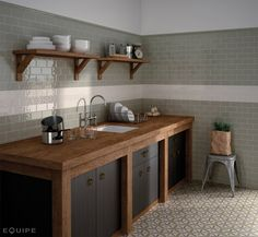 Retro rustic kitchen with olive and cream tiles and wooden counters