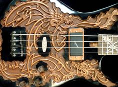 """Pin 1 of 2: Blueberry """"Fierro"""" Electric Bass Guitar. RESEARCH #DdO:) - https://www.pinterest.com/DianaDeeOsborne/instruments-for-joy/ - INSTRUMENTS FOR JOY. This $1,000 magnificent electric bass with mahogany body and engraved wood inlays on a rosewood fretboard has FIERRO motif- means IRON. Custom Langcaster pickups from New Zealand. See DETAILS at angle on pin https://www.pinterest.com/pin/349732727288712422/ - MORE BASSES at https://www.pinterest.com/claxtonw/bass-foundation/ -"""