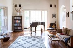 Multiple sources of light—from two bay windows and a door leading to the backyard—flood the great room, an idyllic space in which to compose. | Andrew Bird and Katherine Tsina at Home | Lonny.com