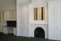 Wardrobes either side of fireplace