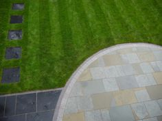Sawn natural sandstone paving with silver granite setts and blue/grey natural limestone paving with brick border. Natural stone patio project in Liverpool.