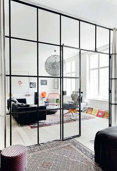 Glass room dividers / elle decoration UK -- This room divider creates definition without obstructing views and light - an important consideration if you have a small, dimly lit space. Home Living Room, Living Spaces, Small Living, Door Design, House Design, Wall Design, Glass Room Divider, Room Dividers, Sweet Home