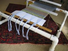 DIY Weaving Loom Awesome! My mom has a PVC quilt frame she isn't using anymore. I might just convert it over. All the parts are there!