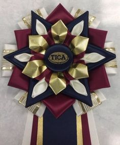 View our collection of ribbons and rosettes available in accents including floral, patterned, glittery golds, silvers and more. Ribbon Making, How To Make Ribbon, Giant Bow, Mums The Word, Ribbon Rosettes, Homecoming Ideas, Kanzashi Flowers, Centaur, Festivals