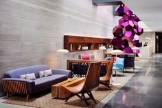 With design furniture and bespoke art pieces scattered around, the lobby area also serves as an open-space gallery.