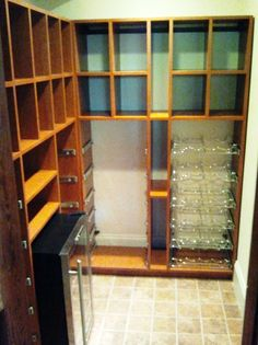 Walk in wine room with pull out wire shelving and mini fridge in Cognac