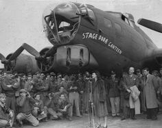 "Vivien Leigh speaks to personnel of the U.S. 381st Bomb Group at the christening of the newly-delivered B-17G Flying Fortress nicknamed ""Stage Door Canteen"" during a visit to Ridgewell with Lieutenant Mary Churchill (daughter of the Prime Minister), Lawrence Oliver (at far right), and Alfred Lunt (April 21, 1944)."