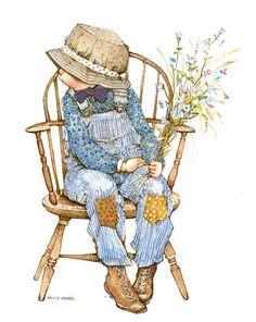 robbie niño vestido de azul sentado en silla