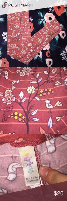 Lularoe OS Legging Super cute OS Lularoe legging. Rosy colored background with pink stripes. Yellow birds and flowers with hints of blue leaves. Adorable with a yellow top or maroon top. Gently used. Worn 2-3 times. LuLaRoe Pants Leggings