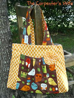 HoOtie HOooo.... Owls and orange dots, pleated diaper bag with rosette...... FREE shipping. $48.00, via Etsy. @Megan Lewis cute!