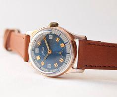 Unisex wrist watch ZIM, blue, brown, gold tones, Soviet Union. $44.00, via Etsy.