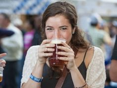 Oktoberfest Zinzinnati breaks attendance records. Photo: Mary Kate Gladstone of Xavier University tries the Oktoberfest beer from the Great Lakes Brewing Co. Joe Simon for The Enquirer