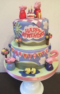 My Peppa Pig cake is two tiers of vanilla sponge with fondant icing