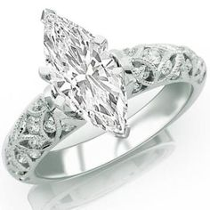 https://ariani-shop.com/099-carat-marquise-cut--shape-14k-white-gold-vintage-style-channel-set-filigree-diamond-engagement-ring-d-e-color--si2-clarity- 0.99 Carat Marquise Cut / Shape 14K White Gold Vintage Style Channel Set Filigree Diamond Engagement Ring ( D-E Color , SI2 Clarity )