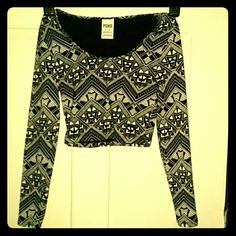 """VICTORIA'S SECRET PINK LONG SLEEVE CROP TOP XS VICTORIA'S SECRET PINK LONG SLEEVE CROP TOP IN SIZE XS  COLOR: BLACK & WHITE TRIBAL DESIGN  LONG SLEEVES  ROUND SCOOP NECKLINE  94% COTTON - 6% ELASTANE MACHINE WASH AND DRY  MEASUREMENTS: CHEST 11"""" ACROSS SHOULDER TO SHOULDER TO 14"""" SLEEVES 21"""" From top to bottom Total Length 14""""  Like new! PINK Victoria's Secret Tops Crop Tops"""