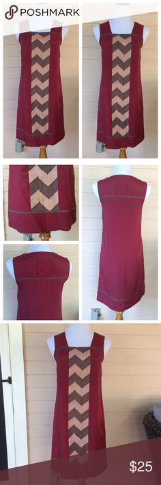 "Jessica Simpson maroon/grey shift dress Fabulous and comfortable dress by Jessica Simpson has a hidden side zipper, taupe/grey chevron details the front length of the dress.  Simply adorable 🔹fully lined🔹100% poly shell, liner 96% poly/4% spandex🔹 length 33.5""   🚫trades 🔹 Reasonable offers accepted Jessica Simpson Dresses"