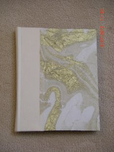 Medium size blank book with with spine and Thai marbled paper. Made by Roxanne