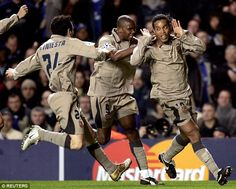 Ronaldinho (right) is joined by Samuel Eto'o (centre) and Andres Iniesta (left) after his goal