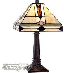 Tiffany Tafellamp Hiryn Small Een bijzonder mooie tafellamp. Helemaal met de hand gemaakt van echt Tiffanyglas. Dit originele glas zorgt voor de warme uitstraling. De voet is vervaardigd van brons. Met 1x kleine fitting (E14). Met schakelaar aan het stroomsnoer. Afmetingen: Hoogte: 38 cm Breedte: 22 cm Diepte: 22 cm