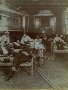 Posse members resting on cots in the United Railway car barn during the Streetcar Strike of 1900.