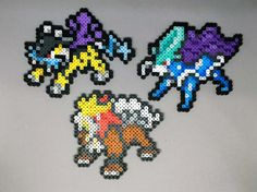 Handmade perler Pokemon creations! Feel free to request a shiny version of the Pokemon for no extra charge!  Here are the sizes: Raikou - 4.75in H x 5.75in W Entei - 4.5in H x 4.75in W Suicune - 4.75in H x 5.5in W  When finished with a necklace, the chain is silver plated and closed with a lobster clasp.