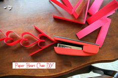 :: Paper Heart chain DiY by becksorange, via Flickr. What a great idea for Valentines day!!