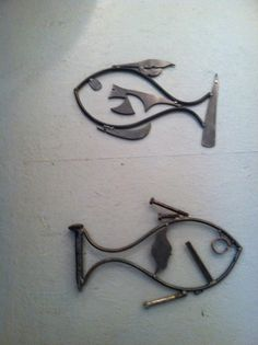 Welded from Steel Scraps | Welded steel FISH sculptures are made from scrap steel, rebar, and ...