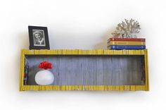 #Magazine, #PaperBooks, #Shelf   This colorful shelf is made entirely from recycled National Geographic magazines. It was designed by Sean Miller. Finalist of the Inhabitat spring greening contest !