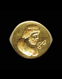 A GREEK GOLD FINGER RING Hellenistic Period, Circa 3rd Century B.C., engraved with a partially draped bust of Asklepios in profile to the right, the bearded god with a large eye and a fillet in his long hair, his abbreviated staff projecting from one shoulder.
