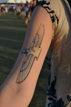 Metallic flash isis tattoo spotted at Coachella