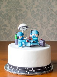 "another pinner said""We went kinda crazy with the hearts and scalpels on this Surgeon cake. We even put sweat on the surgeons thinking that no one would notice, but I guess people do notice these things! Cupcakes, Cupcake Cakes, Crazy Cakes, Medical Cake, Doctor Cake, Grey's Anatomy, Specialty Cakes, Novelty Cakes, Cake Pops"