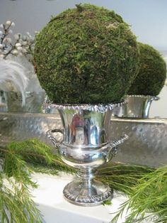 Silver Champagne cooler with large sphere moss ball Christmas Mantels, Noel Christmas, Green Christmas, Vintage Christmas, Christmas Decorations, Holiday Decor, Christmas Ideas, Christmas Gifts, Centerpiece Decorations