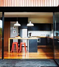Dark cupboards/wooden bench kitchen