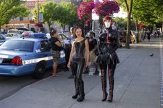 Domina Carmen Moriarty During this stroll with Steffy the Rubberdoll we came across three cop cars and six officers dealing with an incident. We decided to shoot next to them. It turns out the black officer over my right shoulder was Mr. Leather Seattle at the time!!! How awesome is that?!