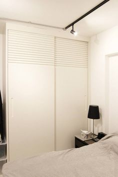 3 room HDB flat in Tampines, Singapore. Louvre sliding wardrobe doors in line with kitchen louvre cabinets.