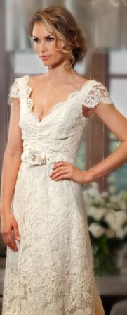 Love the delicate lace dress and the soft curly updo!