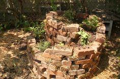 interesting spiral brick planter.  Good for those old bricks left around.