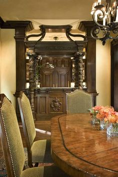 Dining room and incredible detailed wooden wine bar in a Italian Renaissance Villa in Dallas, TX | Richard Drummond Davis Architects