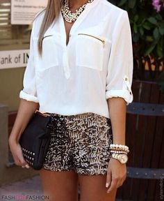 White top, sequin shorts with gold jewelry.