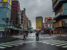 Early this rainy morning at the scramble crossing in front of Kaminarimon, looking east towards the river and Azumabashi bridge. Yes the clouds were so thick that a certain element dominating Asakusa's skyline is almost missing (look closer!) Taken on April 4, 2014. © Grigoris A. Miliaresis