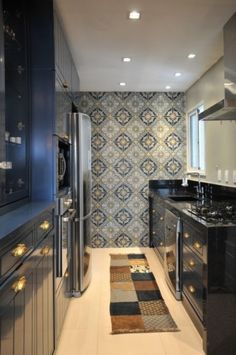 Love the masculine look of the wallpaper with the appliances & color scheme