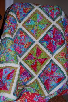 Kaffe Fassett pinwheel lap quilt by Wendy Robards | Caribous Mom.  * Free quilt pattern by Twiddletails: http://www.twiddletails.com/store/index.php?main_page=page&id=24
