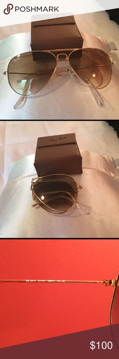 Ray Ban Folding Aviators Rb3479 58mm. Gold frame with brown lense. Upon very close inspection a few imperfections. I didn't even know they were there until I inspected thoroughly. Comes with case pictured and cleaning cloth. Ray-Ban Accessories Sunglasses