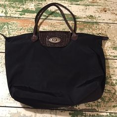 Brighton folding snap tote Black nylon Brighton folding tote that snaps down to a quarter of its size. Fully lined and trimmed in beautiful Brighton leather. A few minor signs of wear. This is a great bag! Brighton Bags Satchels