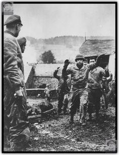"""Officers of the 1st SS Division """"Leibstandarte Adolf Hitler"""" shturmbannfyurera Difental Joseph (Josef Diefenthal) and shturmbannfyurera Gustav Knittel (Gustav Knittel) look at the prisoners 3rd Battalion, 119th Infantry Regiment, 30th U.S. Infantry Division on the street Belgian town of Stoumont ( Stoumont)."""