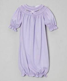 Preciously crafted from soft pima cotton, this gown is the perfect way to dress little darlings in luxurious comfort. With a hand-smocked yoke, ruffled sleeves and hem, it mixes snug charm and easy-change appeal.