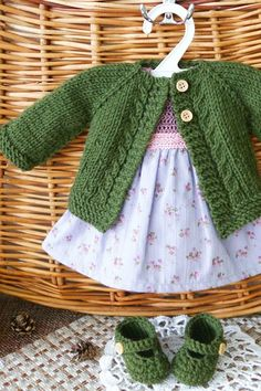Best 11 This set includes a of Green knitted cardigan, lilac cotton dress, green Slippers. Dress – The top of the dress is crochet Crochet Baby Cardigan, Baby Cardigan Knitting Pattern, Knit Baby Sweaters, Baby Knitting Patterns, Baby Boy Knitting, Knitting For Kids, Free Knitting, Doll Dress Patterns, Clothing Patterns