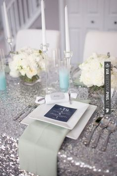 Wow! - Blue Wedding ... Glitter table linen, simple flowers and tiffany blue candles... we would swap the pistachio napkins for more baby blue... | CHECK OUT MORE GREAT WHITE WEDDING IDEAS AT WEDDINGPINS.NET | #weddings #whitewedding #white #thecolorwhite #events #forweddings #ilovewhite #bright #pure #love #romance
