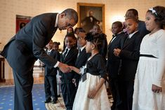 President Barack Obama greets the Zion Baptist Church Children's Choir before the Easter Prayer Breakfast, in the Blue Room of the White House, April 4, 2012. (Official White House Photo by Pete Souza)